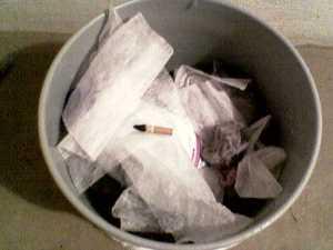 cigarette in lint bucket